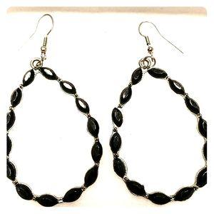 Silver hoop earrings with black crystals